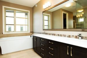 The Windsor - Ensuite - The espresso cabinets are highlighted by the recycled granite and glass quartz countertops.