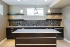 The Windsor – Basement Bar – Floating shelves and a chocolate glass mosaic backsplash give this bar a contemporary statement.