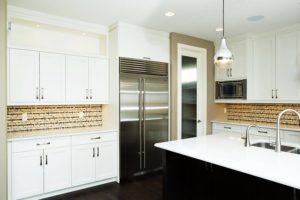 The Windsor – Kitchen – Behind an 8' glass door; a walk through pantry allow ease of grocery and shopping storage.