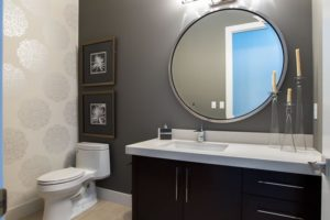 The Soho - Powder Room - This sumptuous space is accented with warm charcoal walls and two toned alabaster wall paper.