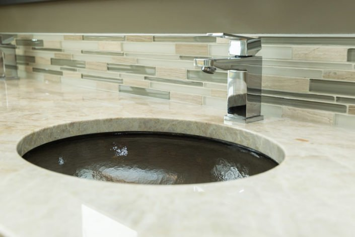The Stratton - Ensuite - The ensuite features warm grey colored glass vanity sinks and exotic Taj Mahal granite.