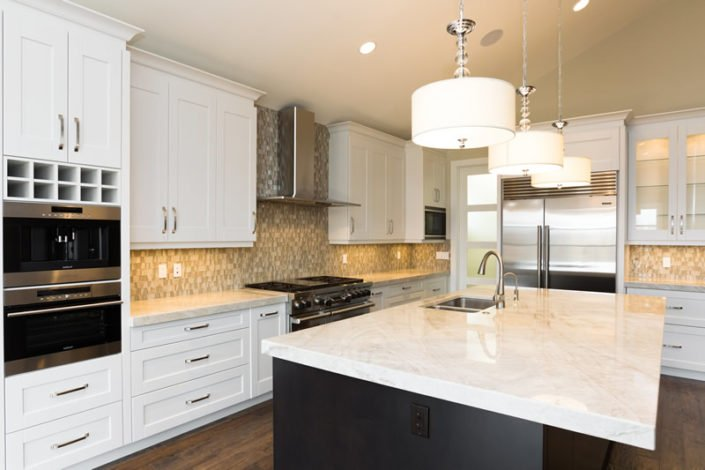 The Stratton – Kitchen – This kitchen invites you to enjoy time cooking and visiting with friends. The multiple appliances including a coffee bar and steam oven add luxury to this space. The countertops are exquisite exotic Taj Mahal granite, which are the highlight of this kitchen.