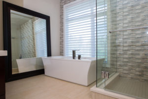 The Soho - Ensuite - The Ensuite is a relaxing retreat; floor to ceiling custom glass shower and free standing tub are connected by a stone and glass mosaic wall.
