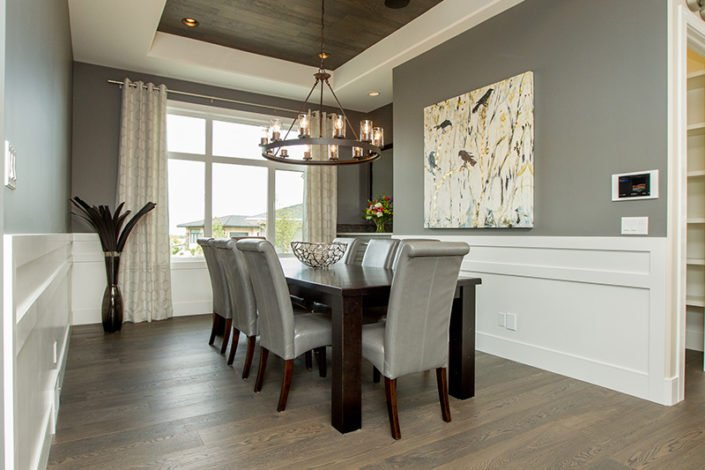 The Manor – Dining – Look up and be pleasantly surprised to see a chocolate brushed oak 12 foot coffered ceiling. This room seats 10 – 12 comfortably and includes a built in side board topped with an exotic white and grey granite. The walls are two toned with a contemporary wainscoting.