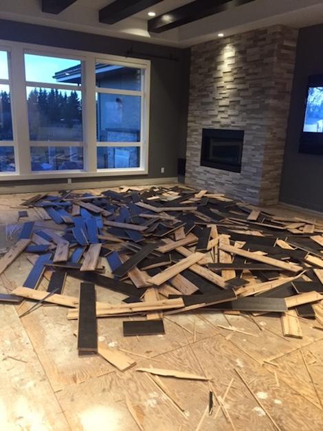 hardwood floor being pulled up for rennovation