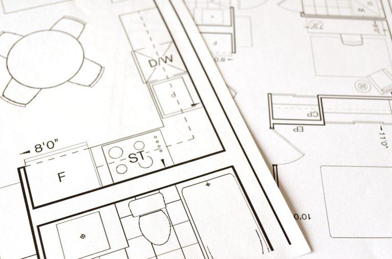 custom floor plan designs laid on the desk