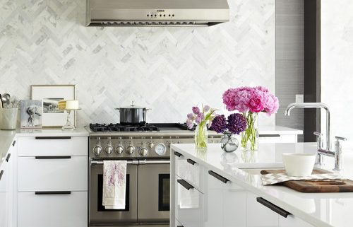 Luxury home with marble tile backsplash.
