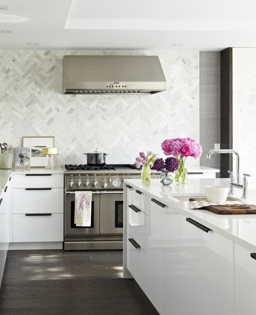 Luxury home with marble tile backsplash.